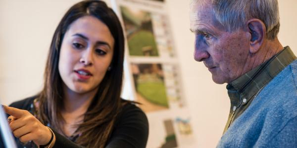 Environmental design student explains her research to a community member