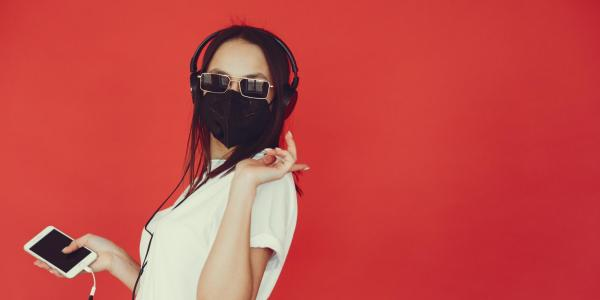 Girl listening to music with mask