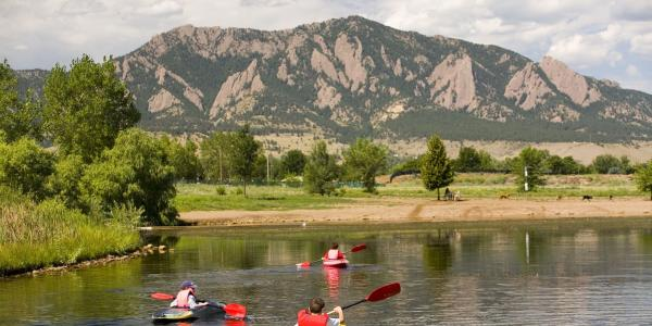 Kayakers with the Flatirons in the background