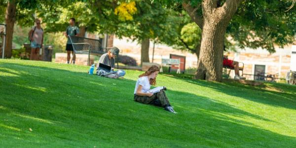 students studying outdoors on campus