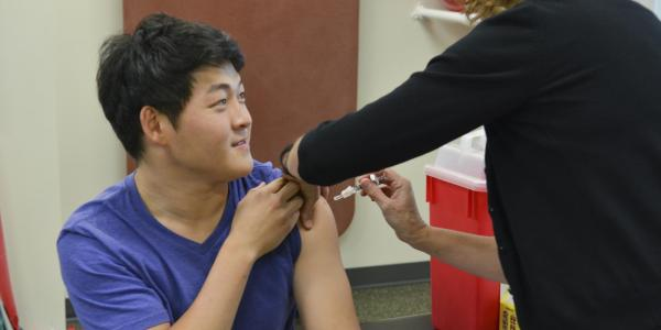 Student receives a free flu shot
