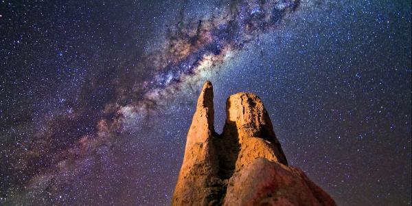 A rock formation on Earth seen during night time (Photo from Pexels)
