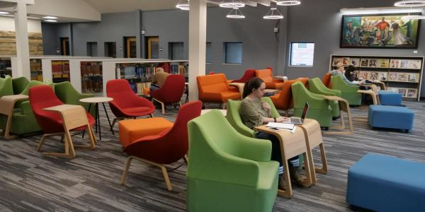 Student studying in music library