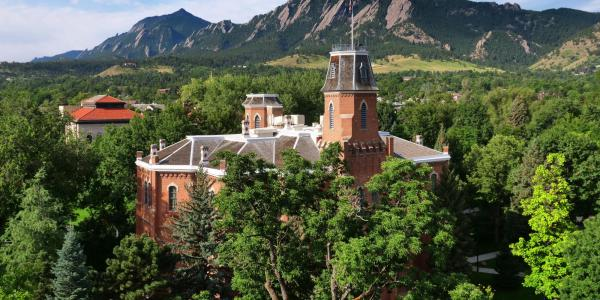 A scenic view of the CU Boulder campus and Old Main.