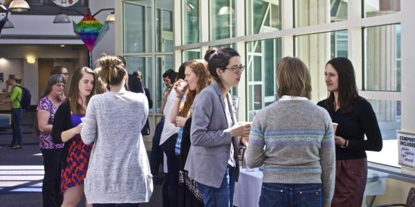 Attendees mingle at the SciComm conference