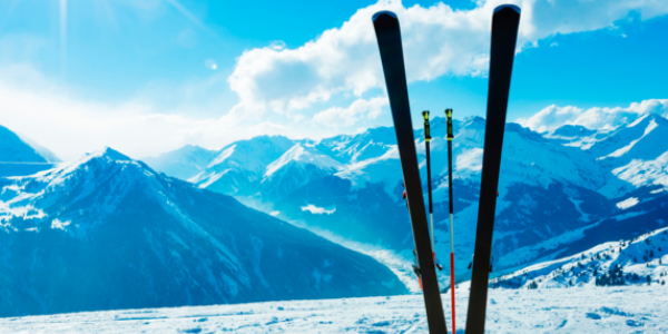 Skis set in the snow on a mountain slope