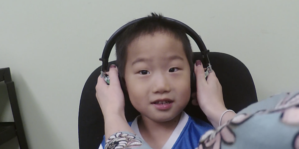 A child having their hearing tested