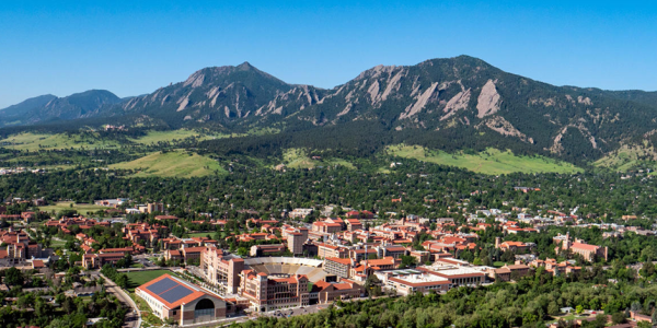 A scenic aerial shot of the CU Boulder campus and Flatirons