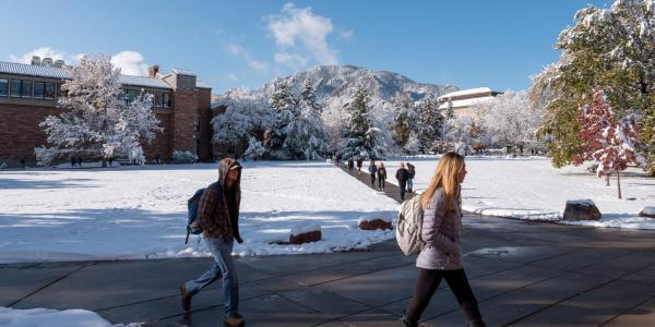students walking on a snowy campus