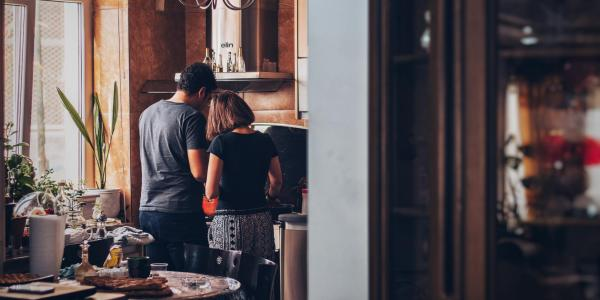 two people cooking in kitchen at home