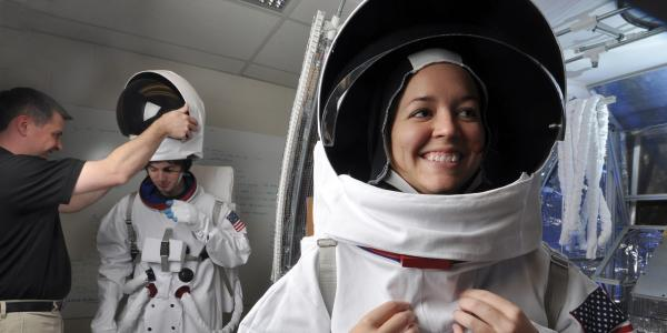 Students wearing space suits