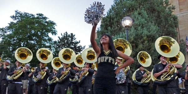 CU Boulder homecoming Stampede with marching band downtown