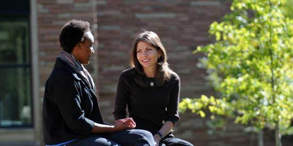 Advisor talks with student