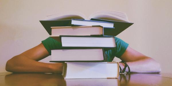 Student buried in books