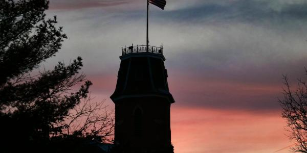 Silhouette of Old Main at sunset
