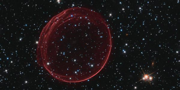 Bubble of expanding gas created by a supernova.