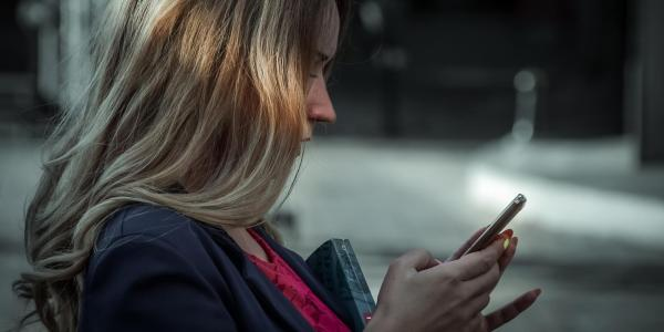 Woman texting on cell phone