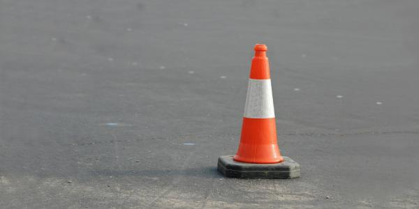 A stock image of an orange traffic cone