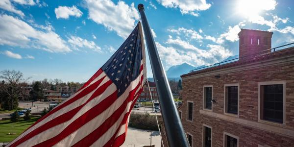 American flag flying at the UMC building