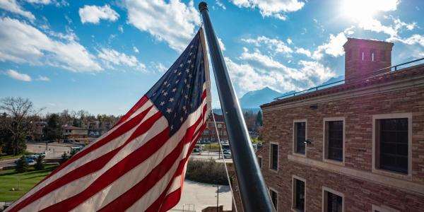 American flag flying in front of UMC