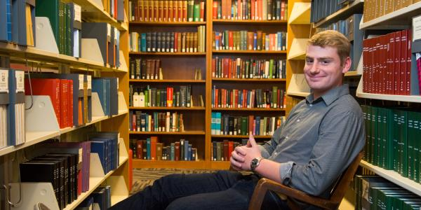Portrait of Nick Zyzda at the stacks in Norlin Library