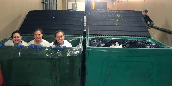 Students pose for photo in recycling bins at Vail Resorts