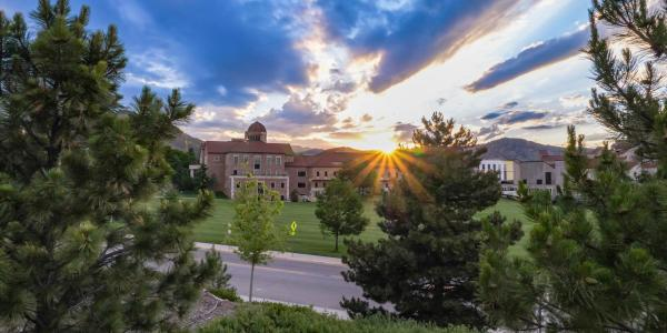 Sun peeking over campus views