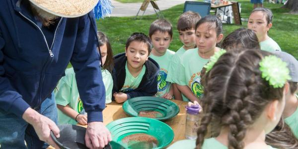 Kids watch as employee demonstrates during Water Festival