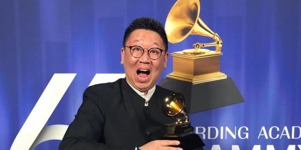 College of Music alumnus Wei Wu poses for photo with Grammy Award