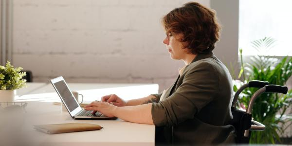 A woman using a laptop computer