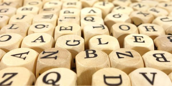 Wooden letter cubes (stock image).