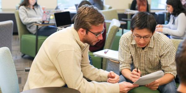 Research expert helping a student during a previous write-in event.