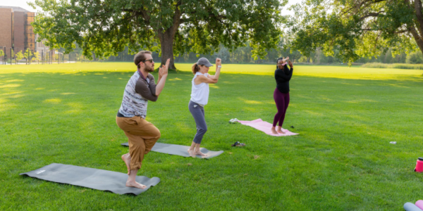campus community members doing yoga on campus