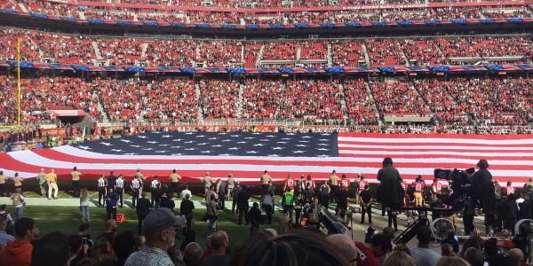 American flag on football field