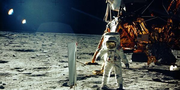 Astronaut Buzz Aldrin standing next to lunar lander