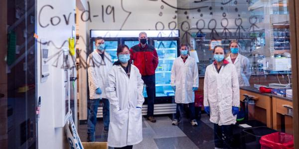 CU Boulder COVID-19 researchers in masks and lab coats