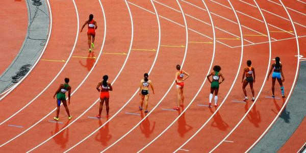 Female runners lining up for track race