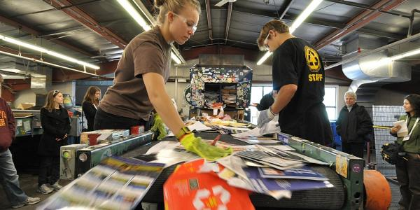 Students sorting recycled materials on campus