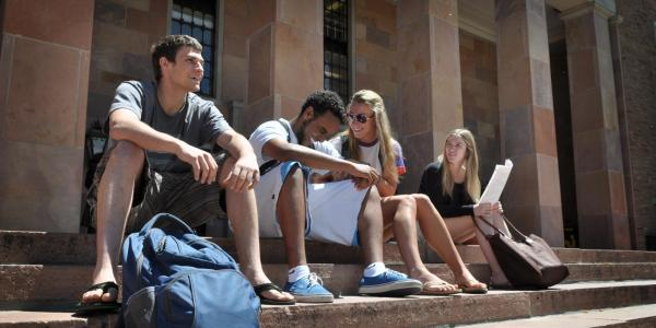 Students sit outside