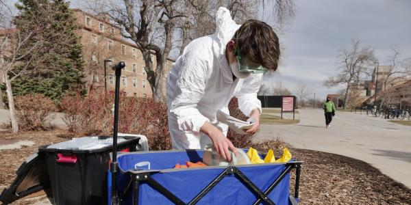 Researcher collecting waste water sample