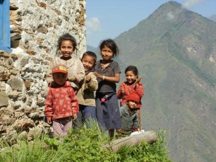 Children standing on a hill