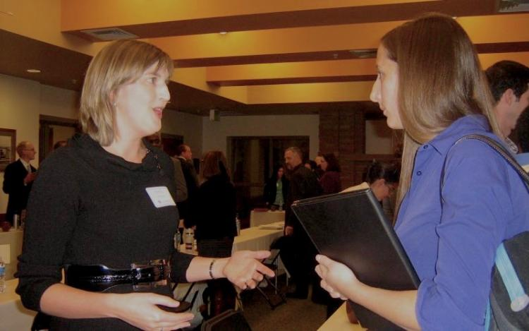 Emily Prehm from the U.S. Department of Health and Human Services, Office of Civil Rights talking with Colorado Law student Tessa DeVault (2013)