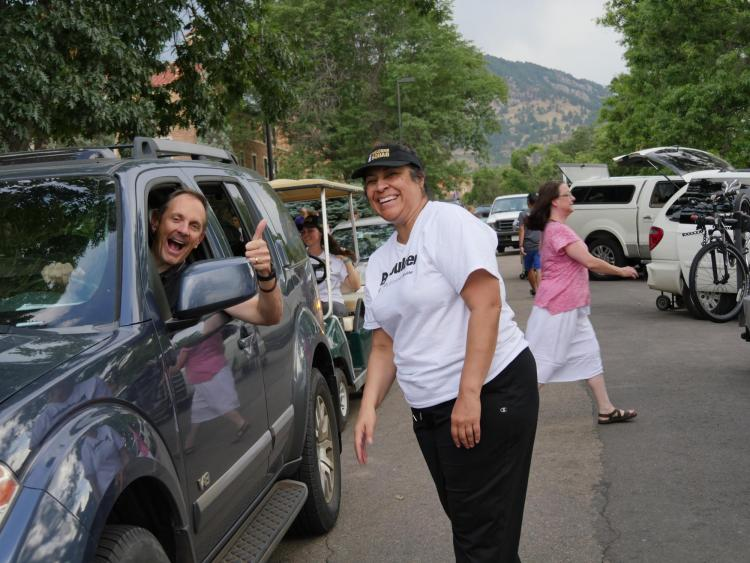 Christina Gonzales, vice chancellor for Student Affairs, directs traffic during move-in 2016.