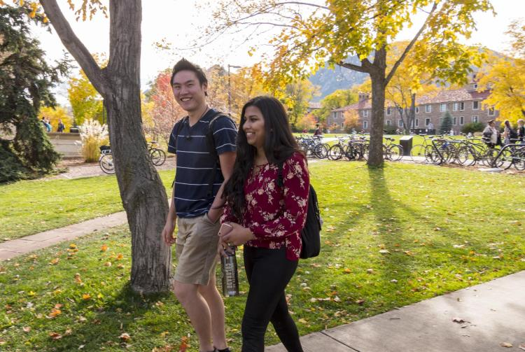 Students walking across campus during fall