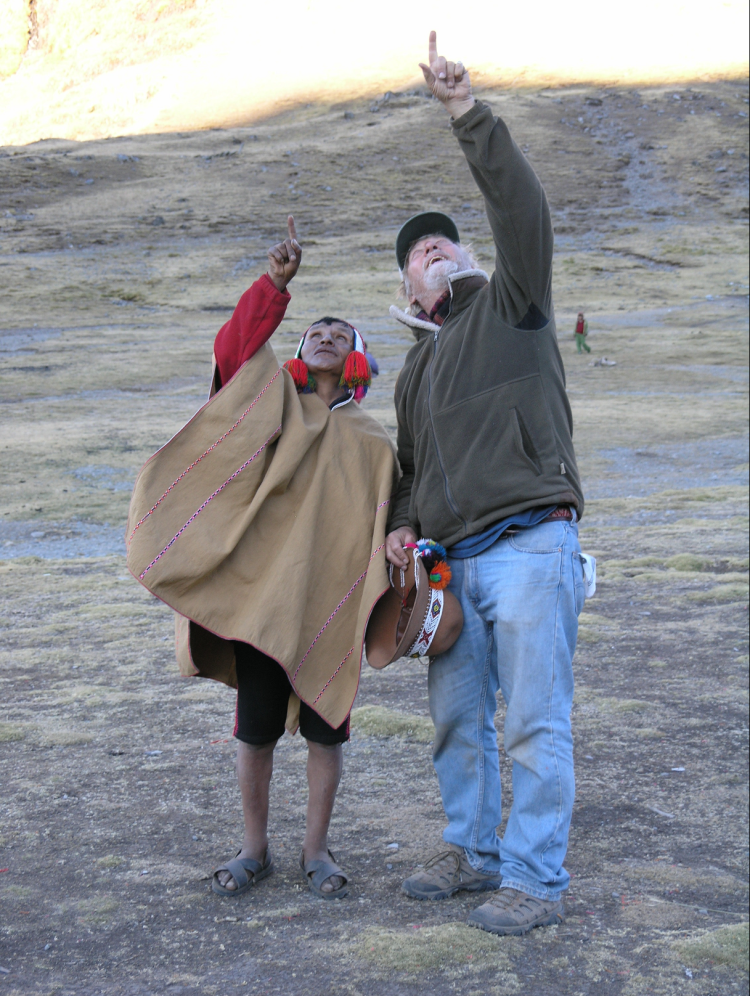 John Stocke points to the sky with a Q'ero tribe member