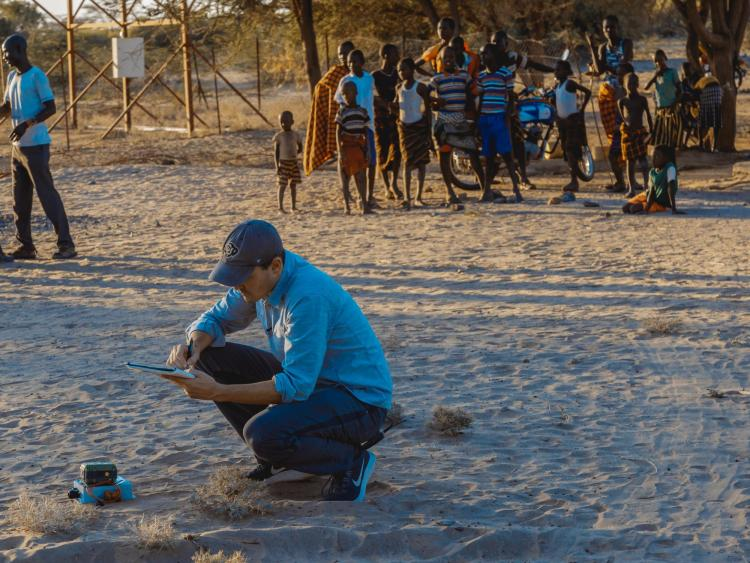 Evan Thomas takes notes while inspecting groundwater sources in northern Kenya