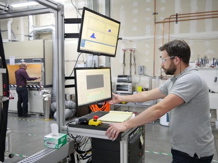 Two CU Boulder alumni work in the ALD Nanosolutions lab