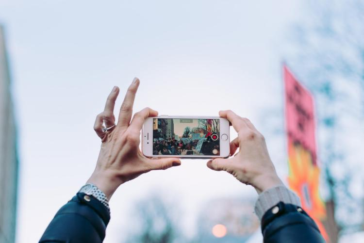 Cell phone being used in public to record a protest