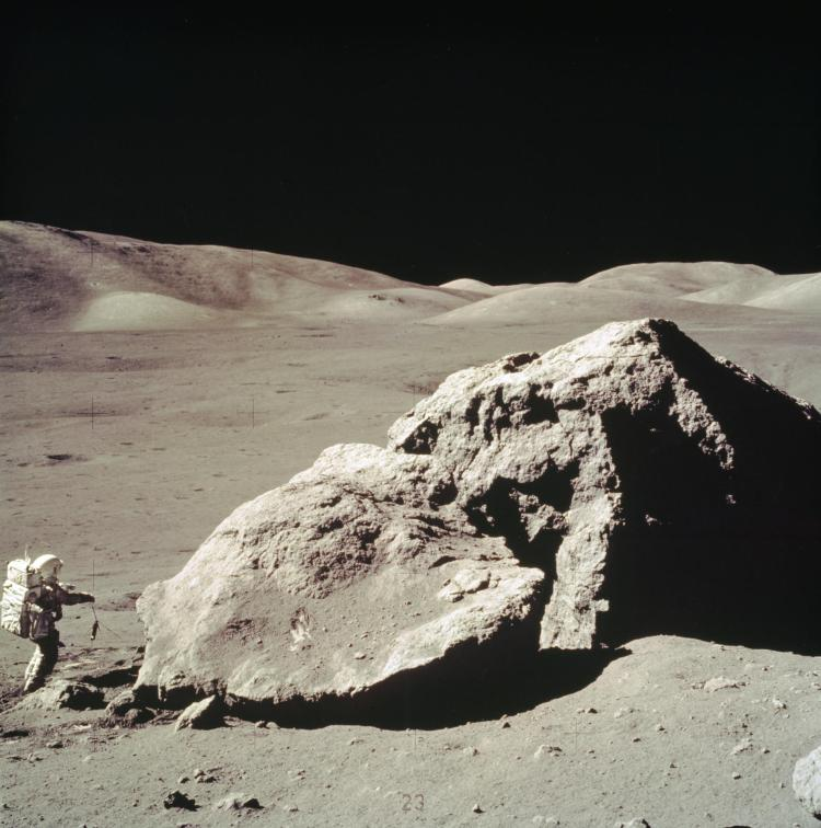 Apollo 17 astronaut Harrison Schmitt near a boulder in the moon's Taurus-Littrow Valley.