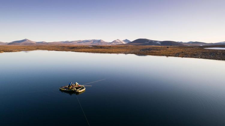 Researchers on a lake